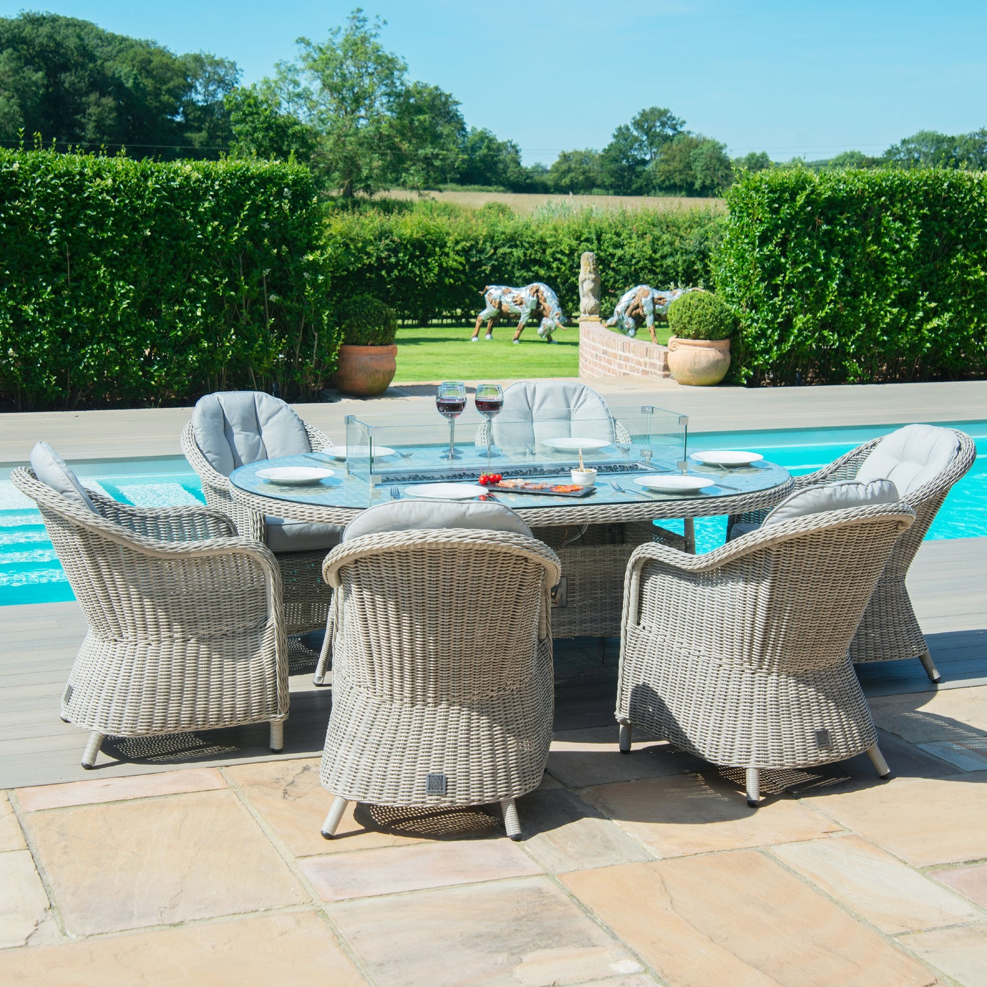 Picture of: Maze Rattan Oxford 6 Seat Oval Fire Pit Dining Set With Heritage Chairs